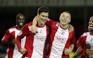 Josh Simpson, left, scored Crawley's equaliser on the stroke of half-time before Swansea hit back