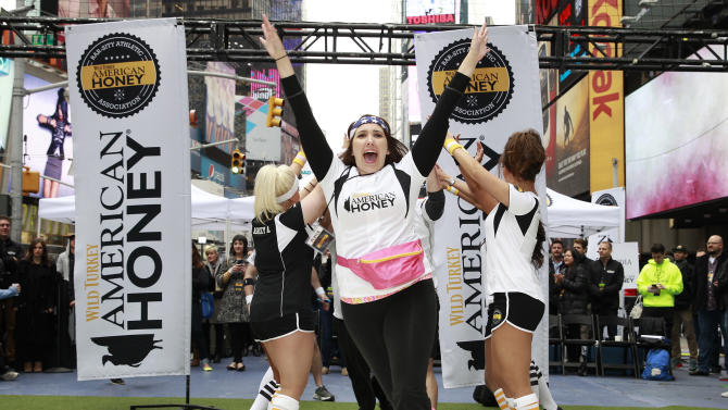 Teammates enter the field at the first ever American Honey Bar-sity Athletics kickball game in Times Square, on Tuesday, April, 23, 2013 in New York City, New York. (Photo by Mark Von Holden/Invision for American Honey/AP Images)