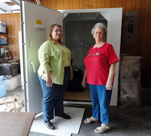 This April 27, 2012, photo provided by Betty Harryman shows Betty her daughter Linda Harryman with the safe room they installed in the garage of their new home following last years tornado in Joplin, Mo. Harryman, 76, was in a Joplin hospital about to have open-heart surgery when the twister hit. (AP Photo/Courtesy Betty Harryman)