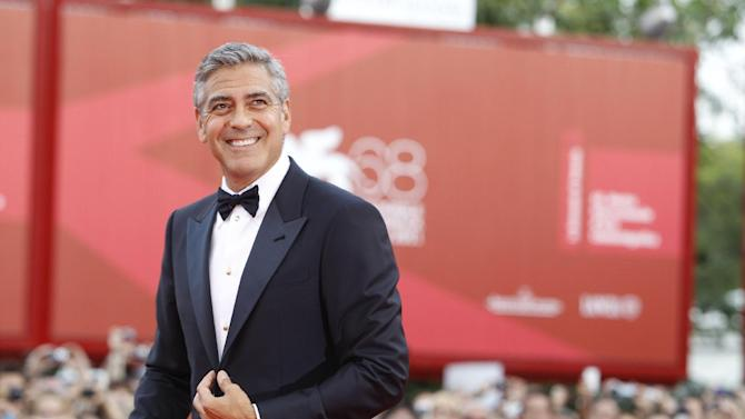 "George Clooney poses on the red carpet for the premiere of his movie 'The Ides of March', which opens the 68th edition of the Venice Film Festival in Venice, Italy, Wednesday, Aug. 31, 2011. Clooney's family drama ""The Descendants"" was chosen Sunday as the year's best film by the Los Angeles Film Critics Association, whose prizes are an early influence on the way to the Academy Awards. (AP Photo/Andrew Medechini)"