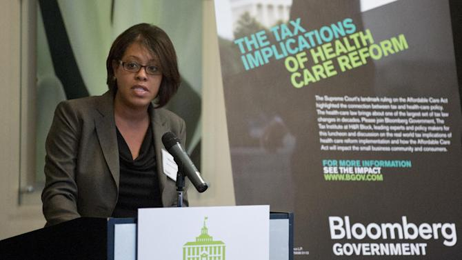 Tiffany Stamps of Bloomberg Government welcomes attendees to an event on the tax implications of health care reform, Thursday, February 28, 2013 in Tallahassee, Fla. The event is part of a multi-city engagement tour hosted by The Tax Institute at H&R Block and Bloomberg Government examining the effects of the Affordable Care Act on consumers, small businesses and the uninsured. (Colin Hackley / AP Images for The Tax Institute at H&R Block)