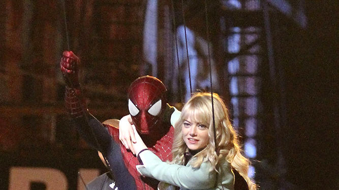 Andrew Garfield and Emma Stone pictured swinging into action on the set of