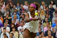 US player Serena Williams plays a double-handed backhand shot during her women's singles quarter-final match against Czech Republic's Petra Kvitova on day eight of the 2012 Wimbledon Championships tennis tournament at the All England Tennis Club in Wimbledon, southwest London. Serena won the match