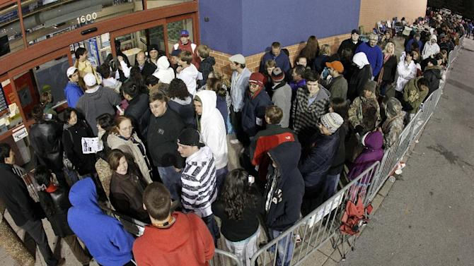 Shoppers wait for a midnight opening at a Best Buy store on Thursday, Nov. 24, 2011, in Brentwood, Tenn. Black Friday began in earnest as stores opened their doors at midnight.   (AP Photo/Mark Humphrey)