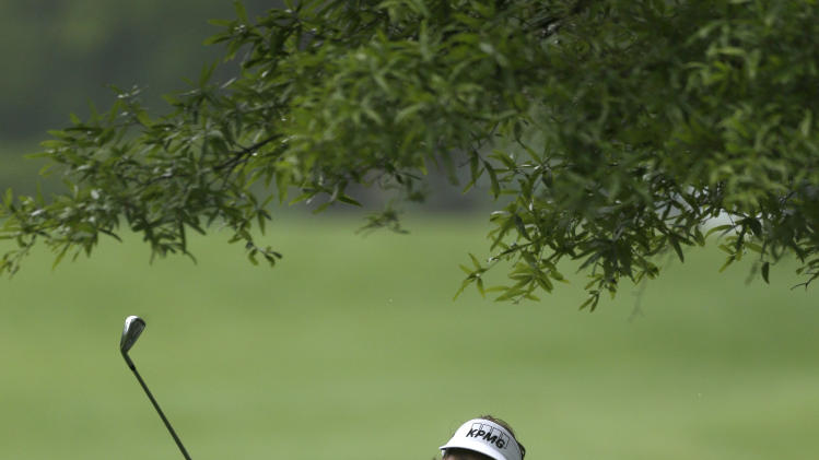 Phil Mickelson watches his approach shot on the 12th hole during the first round of the Wells Fargo Championship golf tournament at Quail Hollow Club in Charlotte, N.C., Thursday, May 2, 2013. (AP Photo/Chuck Burton)