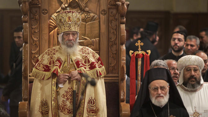 Coptic Pope Shenouda III, left, leads Christmas Eve Mass at the Coptic cathedral in Cairo, Egypt, Thursday, Jan. 6, 2011. Egyptian authorities put up a heavy security cordon around the Coptic cathedral in Cairo hours before Christmas Eve Mass, using bomb-sniffing dogs, metal detectors and officers to try to prevent another attack like the New Year's suicide bombing of a church in Alexandria that killed 21 people. (AP Photo/Ben Curtis)