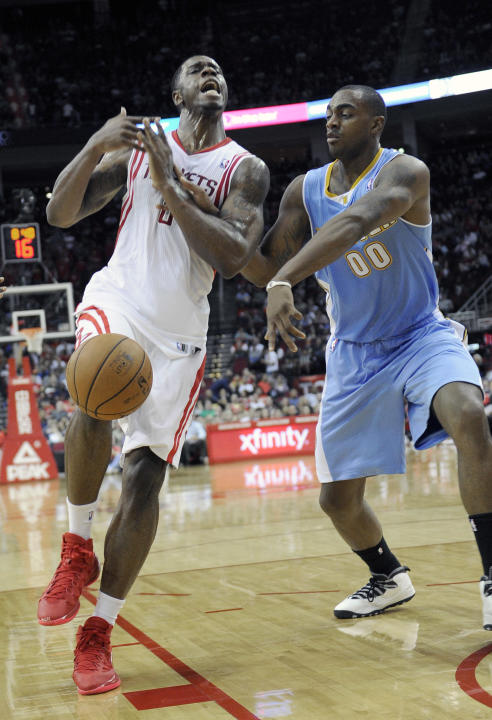 Denver Nuggets' Darrell Arthur (00) knocks the ball away from Houston Rockets' Terrence Jones in the second half of an NBA basketball game Saturday, Nov. 16, 2013, in Houston. The Rockets won 122-111