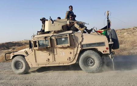 Taliban pull back from Kunduz as fighting flares on southern highway