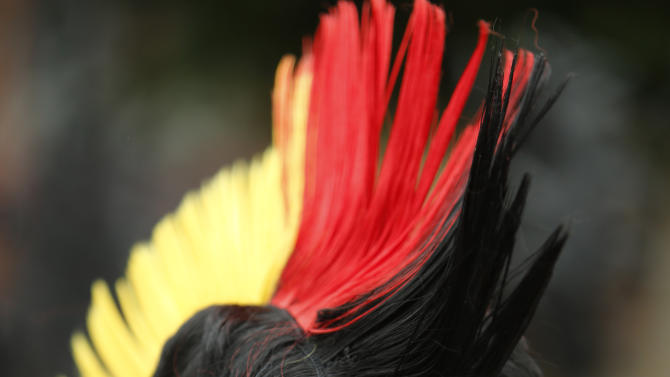 A German fan sports the colors of the German flag before the Euro 2012 soccer quarterfinal match between Germany and Greece in Gdansk, Poland on Friday, June 22, 2012. (AP Photo/Thanassis Stavrakis)