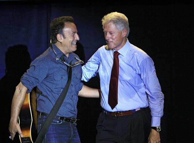 FILE - In this Oct. 18, 2012 file photo, former President Bill Clinton greets singer/songwriter Bruce Springsteen at a campaign event for President Barack Obama, in Parma, Ohio. Dozens of celebrities,