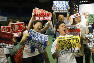 People celebrate after hearing that Tokyo had been chosen to host the 2020 Olympic Games during a public viewing event in Tokyo