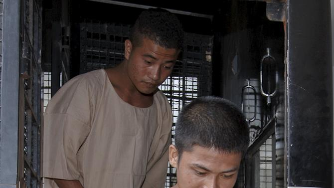 Myanmar migrant workers Zaw Lin and Win Zaw Htun arrive at the Koh Samui Provincial Court, in Koh Samui