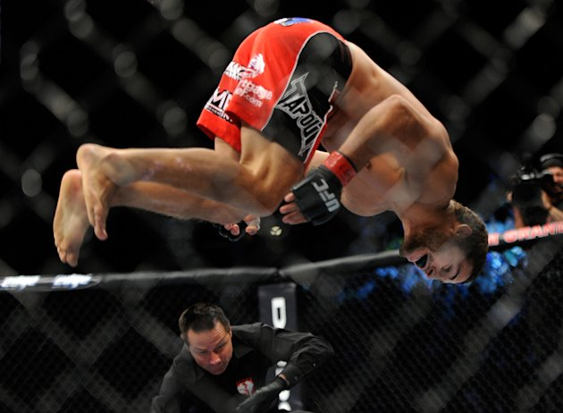 Chad Mendes, does a flip after winning his fight against Cody McKenzie by TKO during the first round of their UFC 148 featherweight bout at the MGM Grand Garden Arena, Saturday, July 7, 2012, in Las