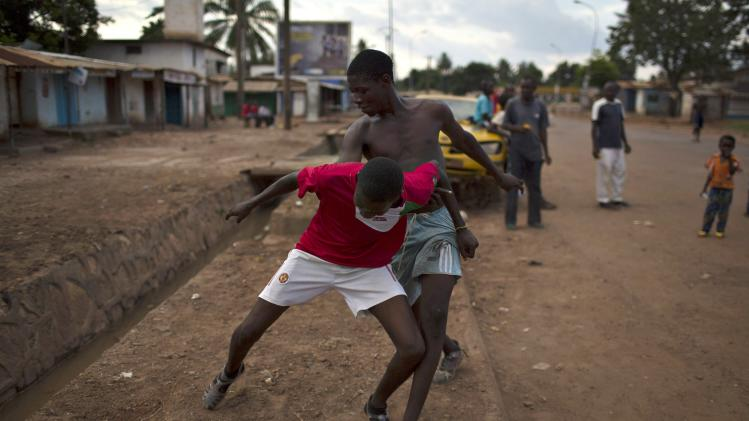 Boys play soccer on the main street of Kilometre 5 (PK5), a predominately Muslim neighbourhood of Bangui