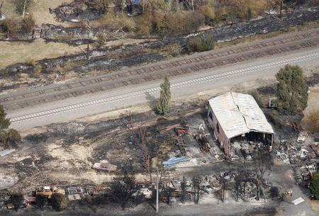 The remains of a house destroyed by bushfires is seen in the town of Kinglake