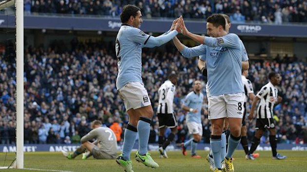 Carlos Tevez (L) celebrates with Samir Nasri (R) during their Premier League game against Newcastle United at The Etihad (Reuters)