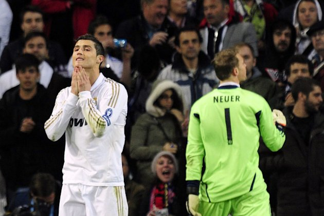 TOPSHOTSReal Madrid's Portuguese Forward Cristiano Ronaldo (L) Reacts AFP/Getty Images