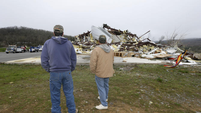 Larry Gammill, left, and Tim Parks survey tornado damage at Botkinburg Foursquare Church in Botkinburg, Ark., Thursday, April 11, 2013, after a severe storm struck the building late Wednesday. The National Weather Service is surveying areas Thursday to determine whether tornadoes or strong winds caused damage. (AP Photo/Danny Johnston)