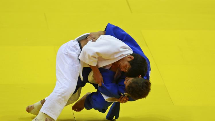 Saw Min San of Myanmar fights with Joel An Hao Tseng of Singapore during the men's Judo 60-66kg event in Naypyitaw
