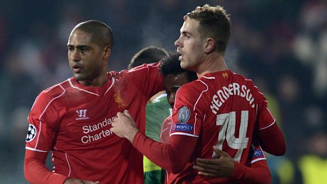 Liverpool's Jordan Henderson (R) celebrates with teamates after scoring a goal during their UEFA Champions League match against Ludogorets Razgrad, in Sofia, Bulgaria, on November 26, 2014