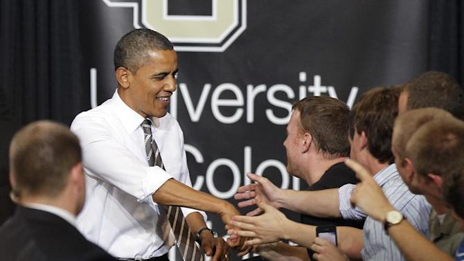 President Barack Obama greets students at the University of Colorado Boulder in Boulder, Colo., on Tuesday, April 24, 2012. Obama spoke about student loans. (AP Photo/Ed Andrieski)