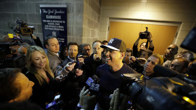 New York Yankees' Alex Rodriguez laughs as he talks with the media before an opening day baseball game against the Boston Red Sox, Monday, April 1, 2013, in New York. (AP Photo/Matt Slocum)