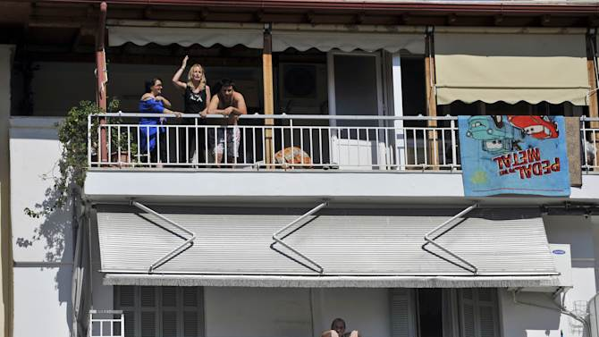 """People in apartments adjacent to a voting station heckled Socialist leader Evangelos Venizelos, shouting slogans such as """"Thieves Out!"""" in Thessaloniki, northern Greece May 6, 2012. Greeks cast ballots on Sunday in their most critical _ and uncertain _ election in decades, with voters set to punish the two main parties that are being held responsible for the country's dire economic straits.  (AP Photo/Nikolas Giakoumidis)"""