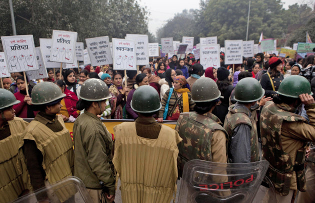 Indian paramilitary women stand guard during a march to mourn the death of a gang rape victim in New Delhi, India, Wednesday, Jan. 2, 2013. India's top court says it will decide whether to suspend law