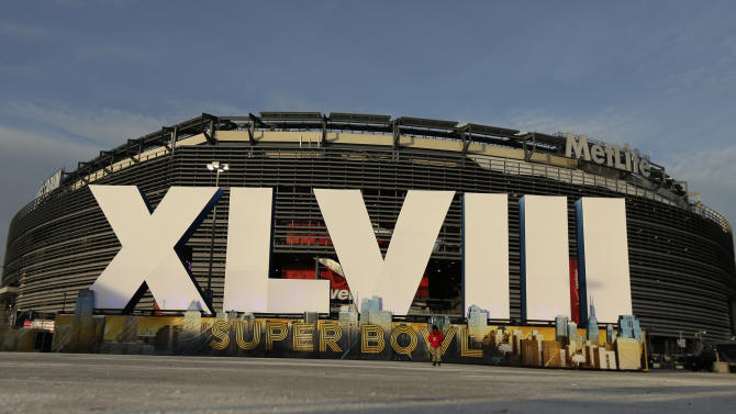 A sign for NFL football's Super Bowl XLVIII stands in front of MetLife Stadium Sat. Feb. 1, 2014, in East Ruthoford, N.J. The stadium will be the site of Sunday's championship game between the Denver Broncos and the Seattle Seahawks. (AP Photo/Charlie Riedel)
