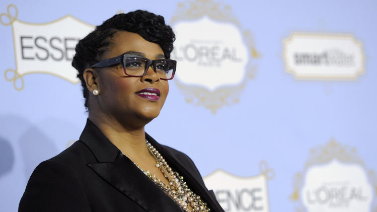 Singer Jill Scott poses at the 6th Annual Black Women in Hollywood Luncheon at the Beverly Hills Hotel on Thursday, Feb. 21, 2013 in Los Angeles. (Photo by Chris Pizzello/Invision/AP)