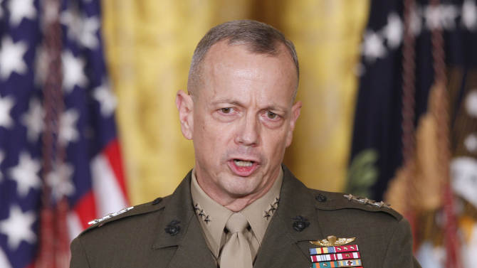 """FILE -- In an April 28, 2011 file photo Marine Corps Lt. Gen. John Allen, speaks in the East Room of the White House in Washington.  The sex scandal that led to CIA Director David Petraeus' downfall widened Tuesday with word the top U.S. commander in Afghanistan is under investigation for thousands of alleged """"inappropriate communications"""" with another woman involved in the case.  (AP Photo/Charles Dharapak/file)"""