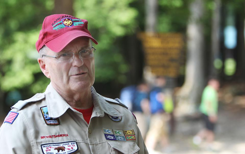 Scout Leader Gerry Boyle talks about being with a group of Boy Scouts Tuesday June 25, 2013 where the evening before a group of Scouts seeking protection from a pouring rain storm suffered burns during a campground lightning strike. Twenty three scouts were taken to area hospitals, none with serious injuries. (AP Photo/Jim Cole)
