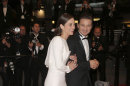 Actors Marion Cotillard and Jeremy Renner depart the screening of her film The Immigrant at the 66th international film festival, in Cannes, southern France, Friday, May 24, 2013. (Photo by Todd Williamson/Invision/AP)