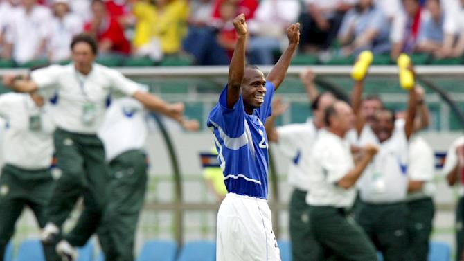 File photo of Brazil's Edilson raises his arms in celebration following a World Cup Finals quarter-final match with England in Shizuoka