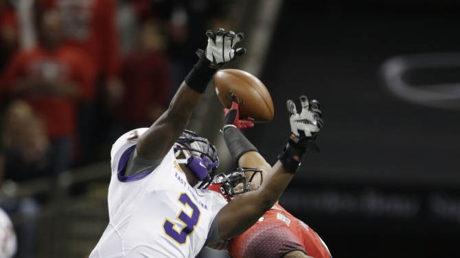 East Carolina defensive back Adonis Armstrong (3) breaks up a pass intended for Louisiana-Lafayette wide receiver Javone Lawson (4) in the first half of the New Orleans Bowl, an NCAA college football game in New Orleans, Saturday, Dec. 22, 2012. (AP Photo/Dave Martin)