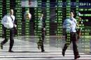 Asian shares sink, euro awaits ECB