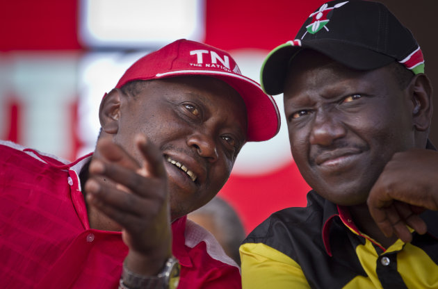 Kenyan Presidential candidate Uhuru Kenyatta, left, and his running mate William Ruto, right, talk together at the final election rally of Kenyatta's The National Alliance party at Uhuru Park in Nairo