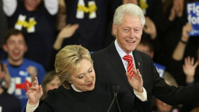 Democratic U.S. presidential candidate Hillary Clinton is accompanied by her husband former President Bill Clinton as she speaks to supporters at her final 2016 New Hampshire presidential primary night rally in Manchester