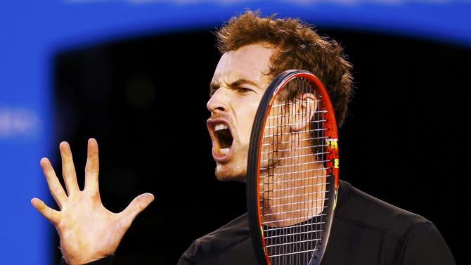 Murray of Britain reacts after hitting a shot against Djokovic of Serbia during their men's singles final match at the Australian Open 2015 tennis tournament in Melbourne
