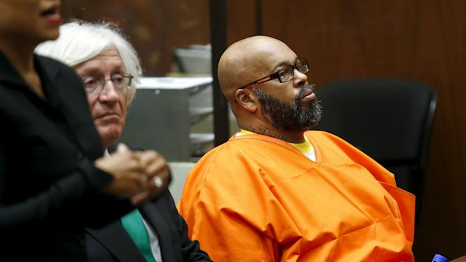 "Defendant Marion ""Suge"" Knight looks on as he attends a hearing with his attorney Thomas Mesereau in his robbery case in Los Angeles, California"