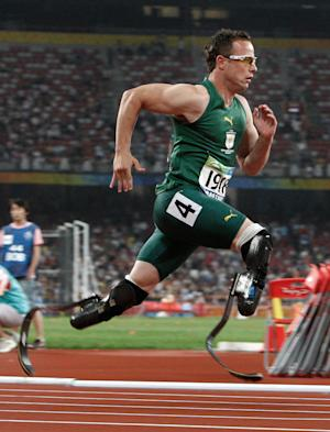 FILE - In this Sept. 16, 2008 file photo, Oscar Pistorius of South Africa competes in the Men's 400m T44 final at the Beijing 2008 Paralympic Games in Beijing, China. Previously banned from competing, and both now cleared to run again after high-profile legal battles, South African athletes Caster Semenya and Oscar Pistorius face defining moments in their young careers at the upcoming world championships. (AP Photo/Andy Wong, File)