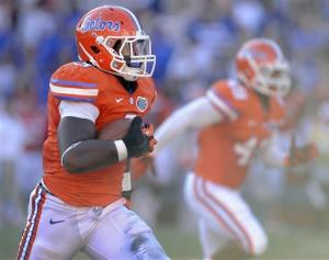 No. 7 Florida scores twice late to beat ULL 27-20