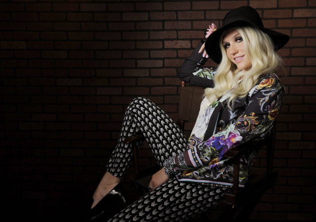 In this Tuesday, Nov. 13, 2012 photo, singer-songwriter Ke$ha poses for a portrait in Los Angeles. Becoming one of pop&#39;s top-selling acts over the past two years hasn&#39;t changed Ke$ha much, the girl who got famous by celebrating the trashy life is still reveling in it. (Photo by Chris Pizzello/Invision/AP)