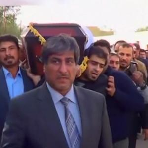Mourners bury news cameraman slain by Syrian insurgents