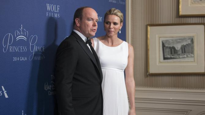 Prince Albert II of Monaco and his wife Princess Charlene pose at the 2014 Princess Grace Awards gala at the Beverly Wilshire Hotel in Beverly Hills