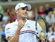 Andy Roddick celebrates after winning against Australia's Bernard Tomic during their 2012 US Open men's singles match at the USTA Billie Jean King National Tennis Center in New York on August 31. Roddick won 6-3, 6-4, 6-0
