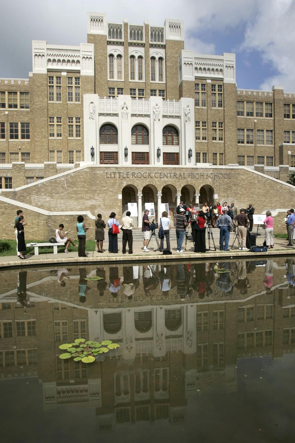 FILE - In this July 16, 2007 file photo, the image of Little Rock Central High School is reflected in a pond during a news conference in Little Rock, Ark. Nine black students desegregated the school in September 1957. (AP Photo/Danny Johnston, File)