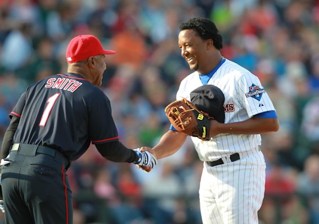 IMAGES DISTRIBUTED FOR PEPSI MAX - Ozzie Smith shakes hands with pitcher Pedro Martinez before batting at 2013 Pepsi MAX Field of Dreams Game on Saturday, May 18, 2013 in Rochester, NY. (Photo by Bill
