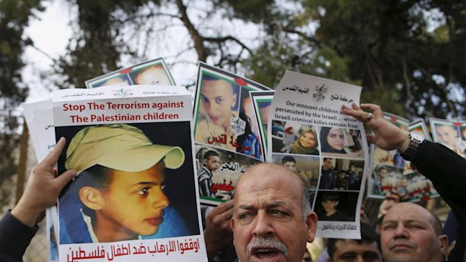 Hussein Abu Khudair, father of murdered Palestinian teenager Mohammed Abu Khudair, takes part in a protest outside the Jerusalem District Court