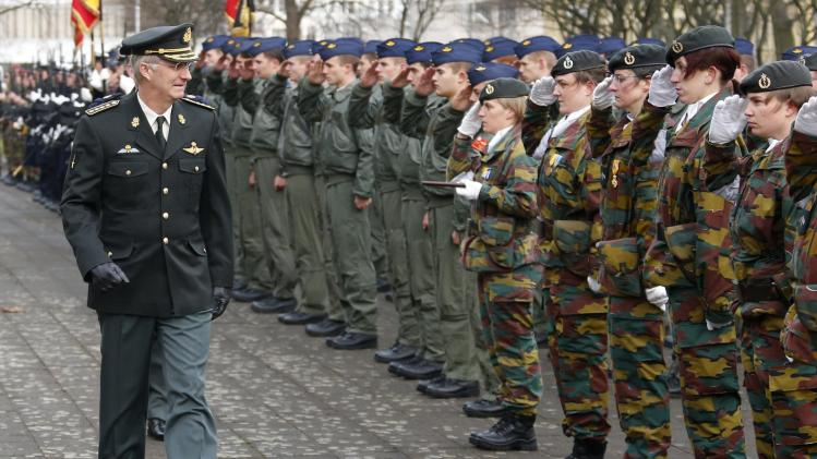 Belgium's King Philippe reviews troops during a visit to the Belgian army headquarters in Brussels